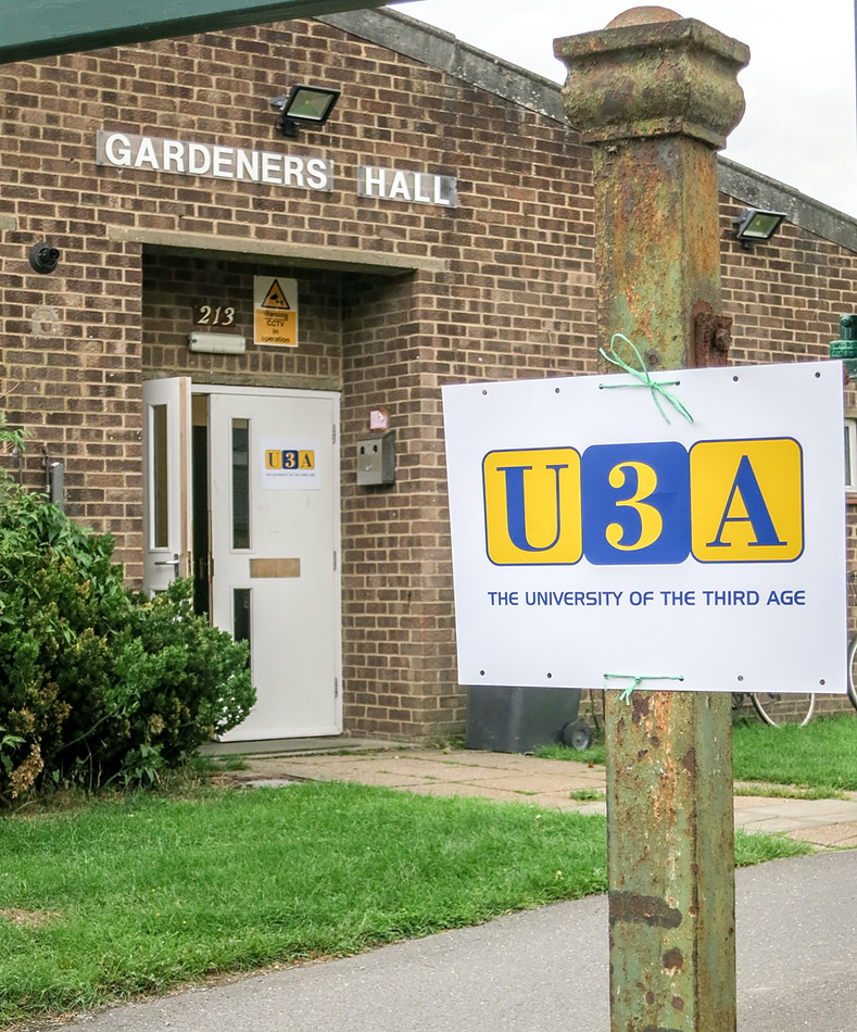 Picture of entrance of Gardeners Hall with signage for U3A monthly meeting