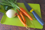 vegetables on a green chopping board
