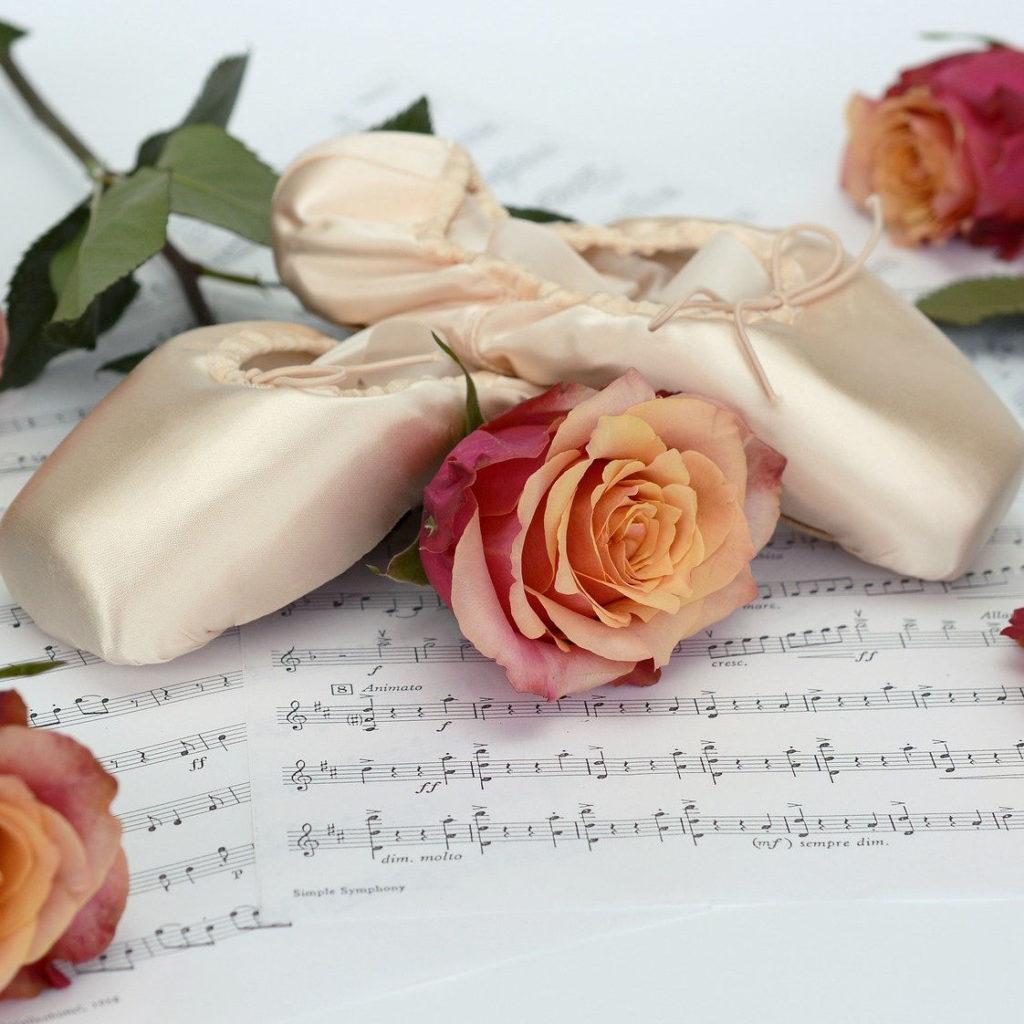 A rose stem on sheet music