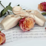 A rose stem on sheet music