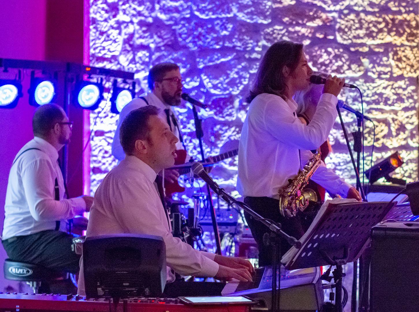 Band singing and playing