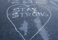'You Got This - Stay Strong' written on road surface